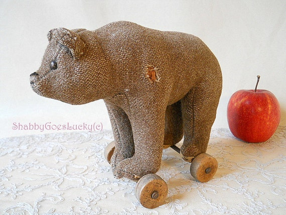 Antique Steiff bear standing on wheels