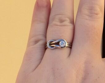 14k white gold 1/4 carat diamond love knot ring