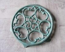 Lovely Vintage French Turquoise Cast Iron Enameled Table Mat,Trivet.