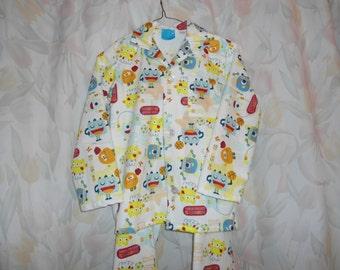 Size 6 Boys Pajamas with Monster Athletics on white background