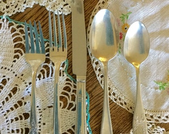 Mixed vintage silver-plate flatware, 5 piece place setting