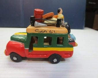Family Bus Made of Clay Traveling With All Their Worldly Goods Ecuador