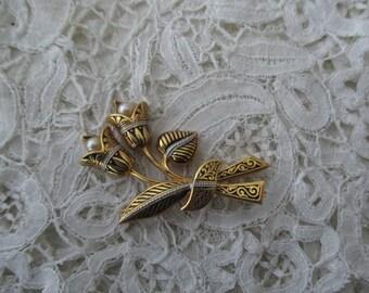 Damascene brooch