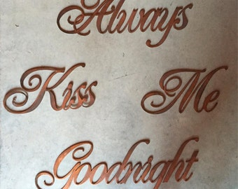 Always kiss me goodnight in metal words with copper finish
