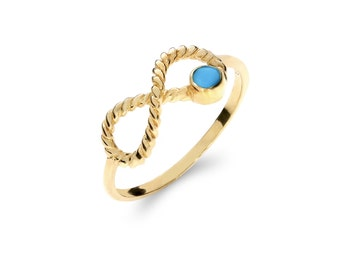14k solid gold infinity ring with turquoise stone.