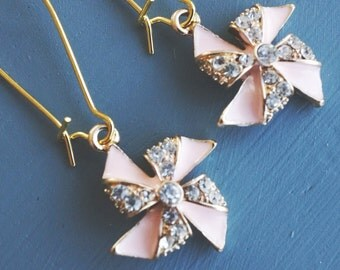 50% OFF SALE Earrings, gold and pink rhinestone pinwheel dangle earrings.