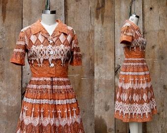 c. 1950s shirtwaist dress + vintage 50s 60s tiki novelty print day dress