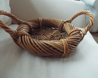 hand woven twig round basket with handles rolled edge