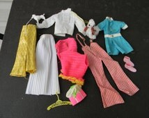 Eleven Barbie Clothing and Accessories Dating Back to the 1970's including Dawn Poodle Hong Kong