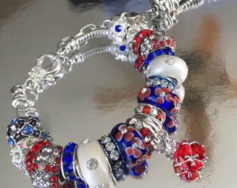 Red, white, and blue European charm braclet with tassel.