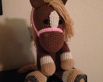 Stuffed horse with horseshoes