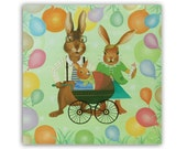 """Bunny Family 5x5"""" card -  Bunny rabbit parents proudly promenade with their new baby in green baby buggy with lots of balloons"""
