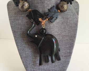Trunk Up Carved Elephant Tribal Necklace
