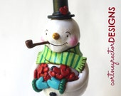 Jolly Snowman with Arm Full of Hearts Folk art sculpture from polymer clay