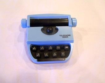 Blue typewriter-shaped telephone index, mechanism still works