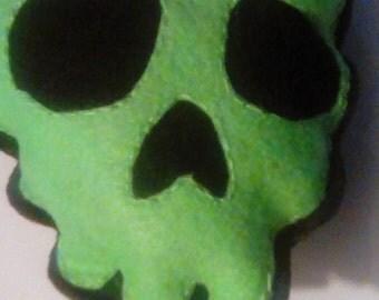 Neon green skull plush pillow