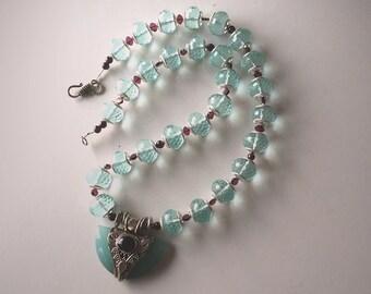 Serafina: Chrysoprase, garnets, sterling silver. Necklace and earring set.