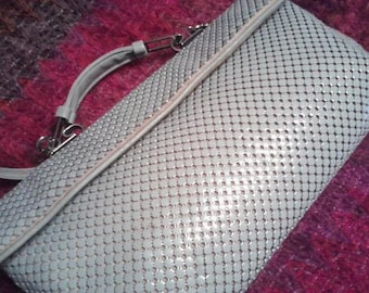 By Leo Narducci glamorous look and appeal to Purse by W & D