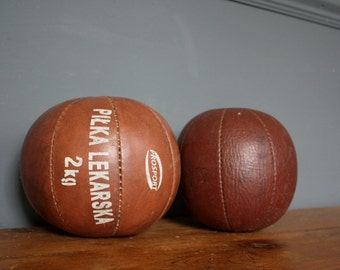 A Pair Of Leather Medicine Balls Circa 1960's