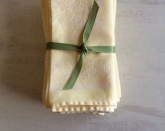 A Set of 8 Vintage Yellow Linen Dinner Napkins