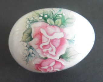 A beautiful white, solid porcelain  egg, accented with pink roses.