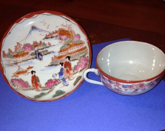 C1800s hand-painted and signed porcelain tea cup and saucer