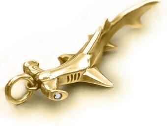 Gold hammerhead shark necklace , gold and diamond pendant.