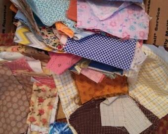 Box of fabric scraps and yardage