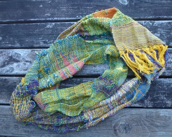 Hand dyed silk and cotton saori hand woven infinity scarf.