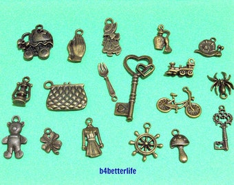 Lot of 18pcs Antique Bronze Tone Metal Charms. #chc111.
