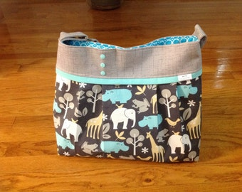 Ready to ship!  Diaper bag in zooligy  Grey and teal.  medium/large, deluxe bag with o rings for stroller