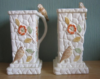 Two 1930's  Embossed Floral Vases/Jugs with Bird on the handle