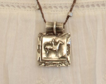 Fine Silver Horseback Rider on a Hand Crocheted Necklace