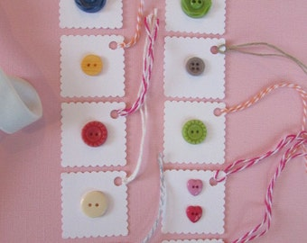 10 Tags With Buttons on Them and Color-Coordinated Twine