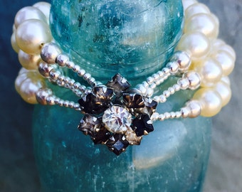 Stunning One Of A Kind Vintage Pearl 4 strand bracelet with antique rhinestone clasp and center