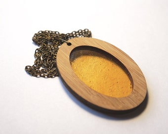 Transparent Yellow/Orange Glass in Wooden Oval Pendant on chain