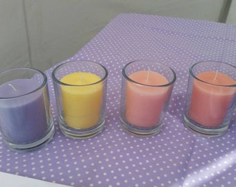 4 Highly scented votives in glass.