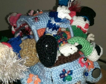Cluster of clowns crocheted toy car with figures