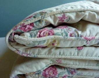 a vintage french flowery quilt, comforter, coverlet