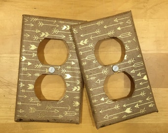 Gold arrow outlet covers