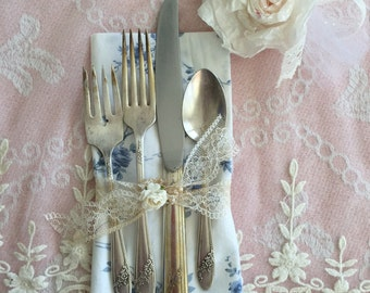 Silverplated vintage flatware with shabby chic napkin