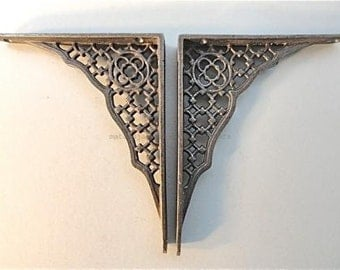 A pair of Gothic revival antique style cast iron shelf brackets