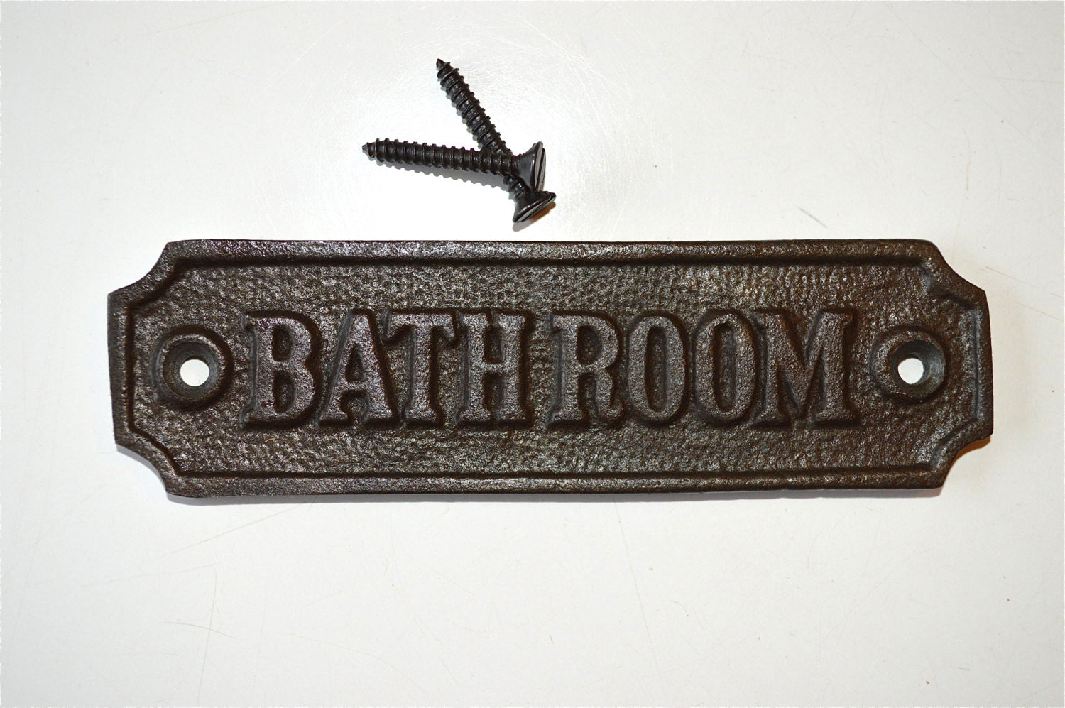 Antique style cast iron bathroom door sign by ...