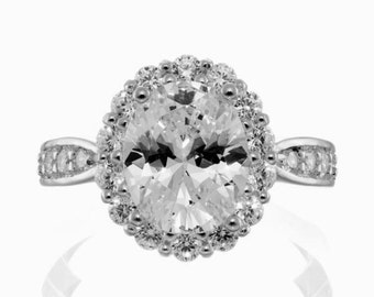 3.5 carat oval cut vintage halo cubic zirconia engagement ring in white gold plated .925 sterling silver