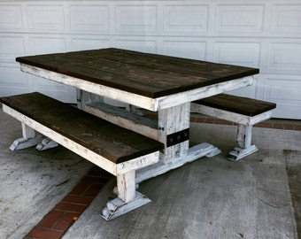 rustic dining table with dark walnut top and white distressed base with steel