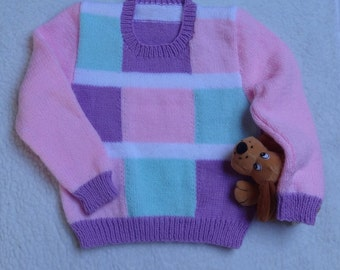 Girls Sweater Size 25 inch chest approx 2 to 3  years. Hand knitted in Multi colour DK yarn.