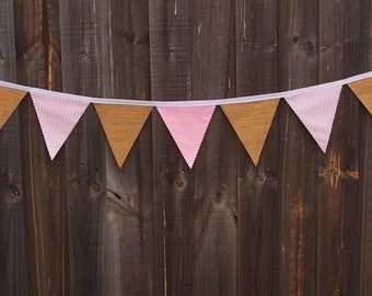 Rustic burlap and light pink cotton bunting with stripes.