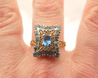Ladies Oval & Round Cut Blue Topaz Cluster Ring 14K
