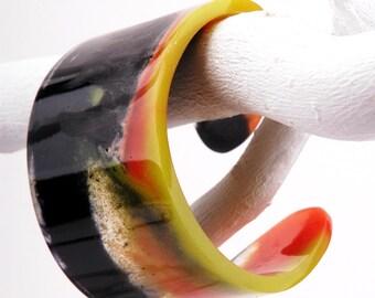 Cuff bangle, black, orange and lemon marbled, fits S