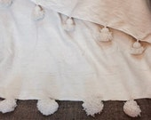 moroccan blanket with pompoms  loomed by hand